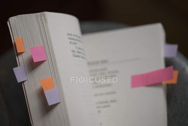 High angle view of open book with colorful bookmarks — Stock Photo
