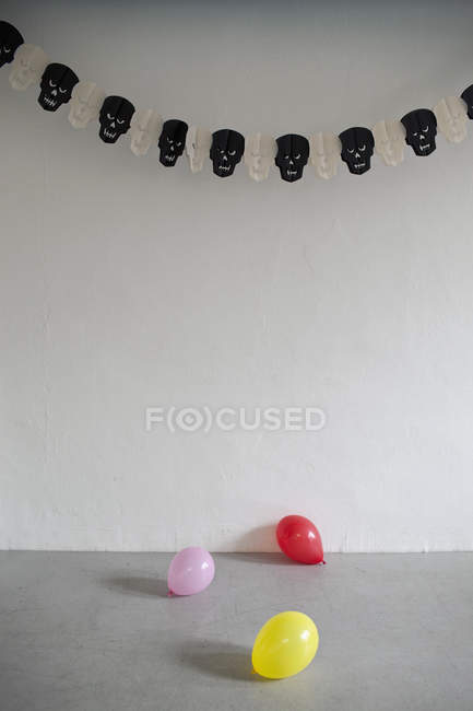 Room decorated with balloons and bunting — Stock Photo