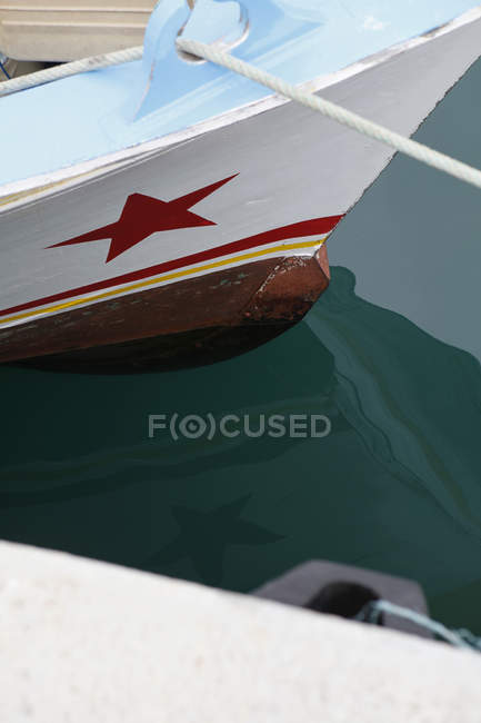 Detail of moored boat with red star — Stock Photo