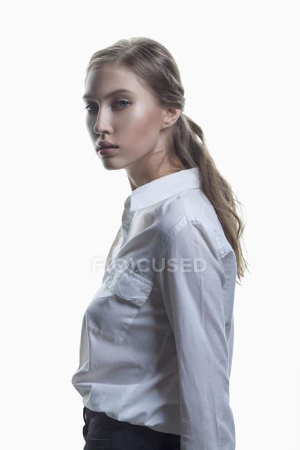 Portrait of beautiful fashion model against white background — Stock Photo