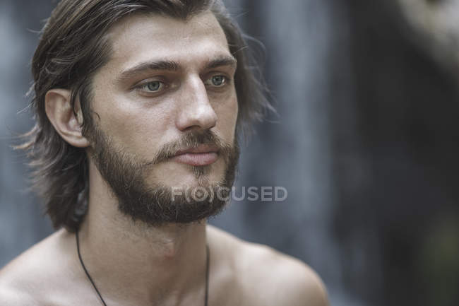 Close-up of thoughtful shirtless young man looking away — Stock Photo