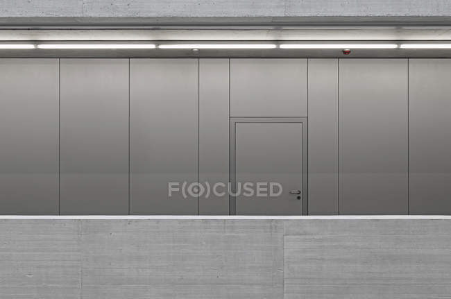 Interior view of closed door on metallic wall in office — Stock Photo