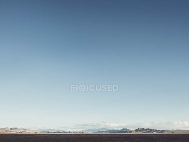 Distant view of mountains range against clear blue sky — Stock Photo