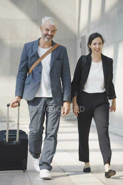 Business colleagues walking with bag in airport — Stock Photo