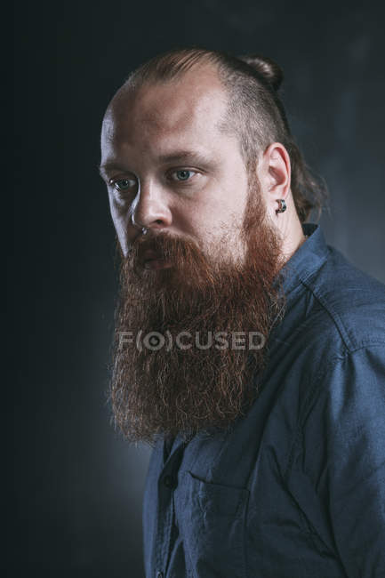 Close-up of thoughtful hipster against gray background — Stock Photo