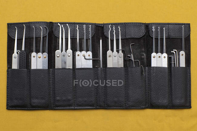 Lock picking set in leather pouch on yellow background — Stock Photo