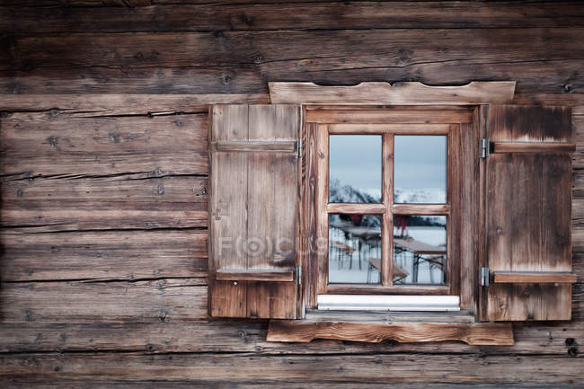 Reflection on glass window of log cabin, Kufstein, Tyrol, Austria — Stock Photo