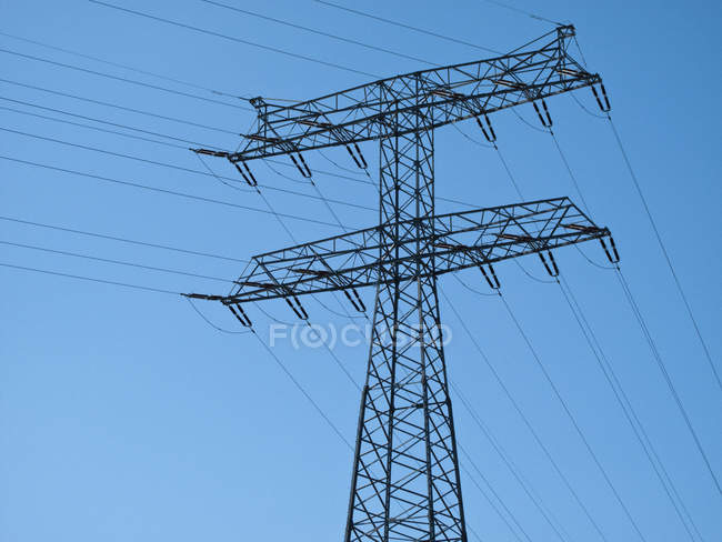 Electricity pylon over blue sky — Stock Photo