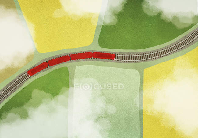 Иллюстрация поезда на путях посреди поля — стоковое фото