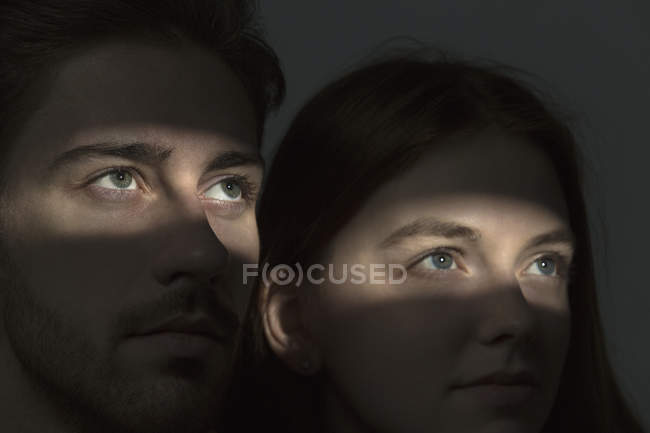 Close-up of Light falling on couples eyes in dark — Stock Photo