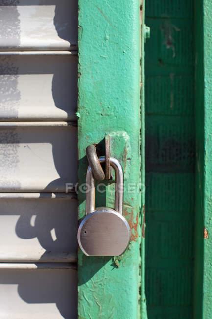 Close up view of locked padlock on door — Stock Photo