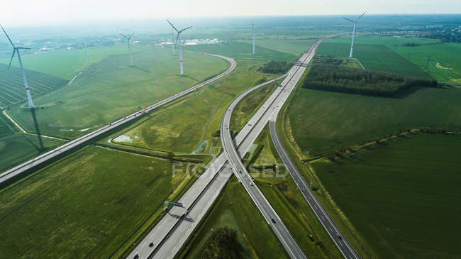 Aerial view of highways and wind turbines on field — Stock Photo