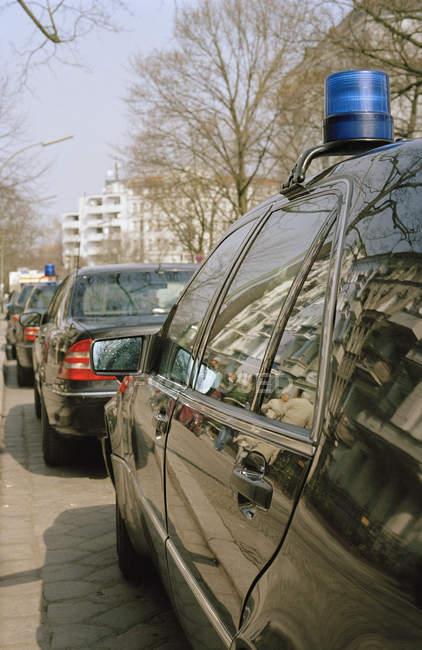 Row of stationary police cars on street — Stock Photo