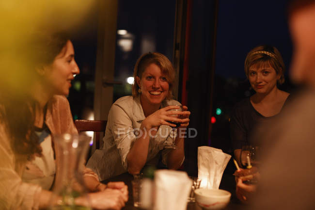 Happy female friends enjoying birthday party at home — Stock Photo