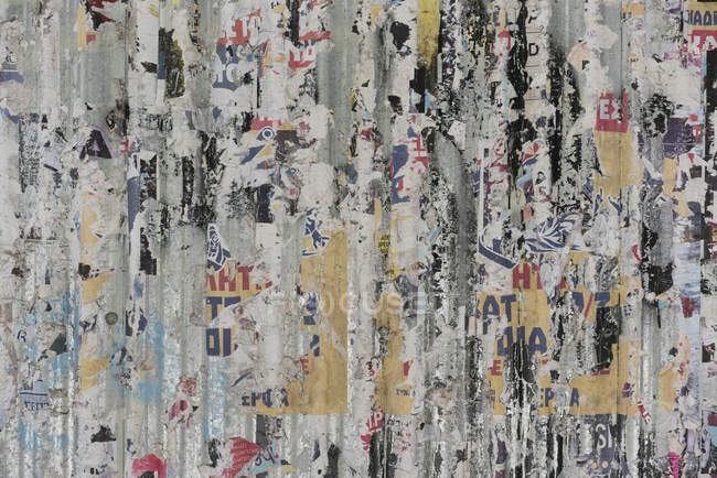 Full frame shot of peeling posters on weathered wall — Stock Photo
