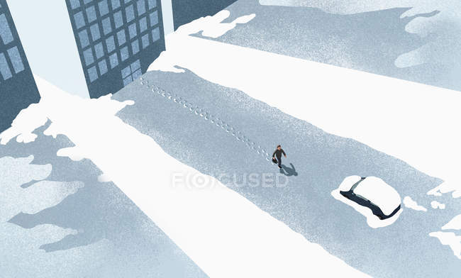 High angle view of man walking on snow covered road in city — Stock Photo