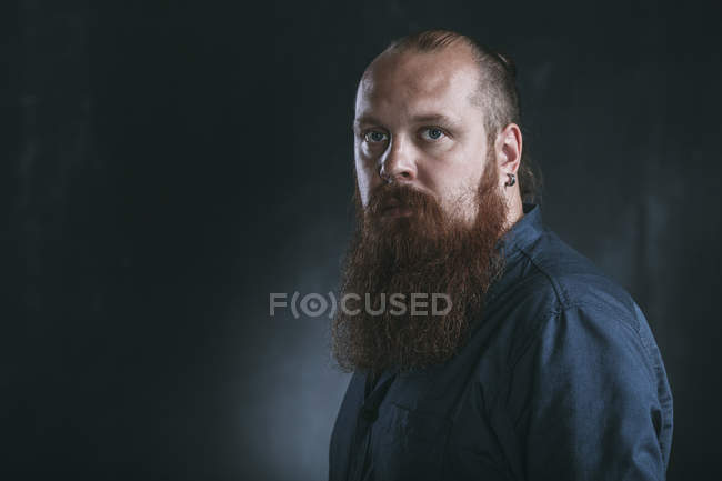 Portrait of serious hipster against gray background — Stock Photo