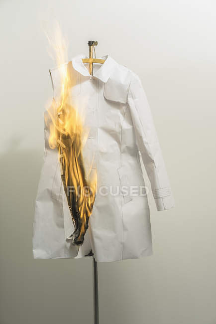 Burning fashion sample pattern against wall in design studio — Stock Photo