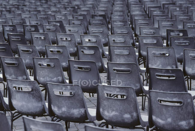 Full frame shot of empty chairs in row — Stock Photo