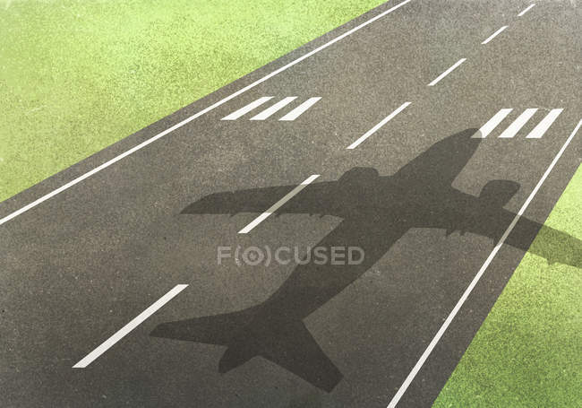 Shadow of airplane on runway amidst field — Stock Photo