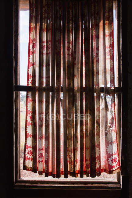 Curtain hanging over window — Stock Photo