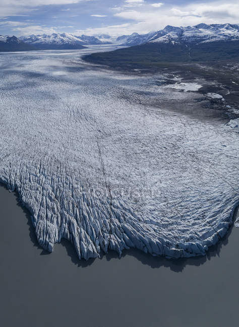 Aerial view of glacier by lagoon — Stock Photo