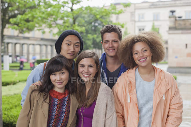 Portrait of smiling multi-ethnic young friends standing outdoors — Stock Photo