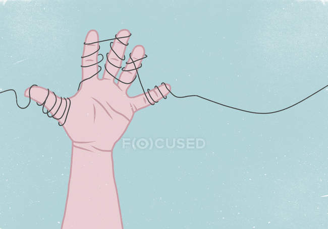 Hand wrapped in thread against blue background — Stock Photo