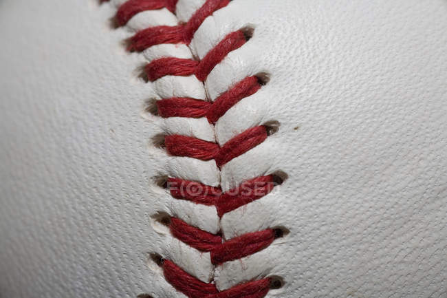 Full frame shot baseball with red stitching — Stock Photo