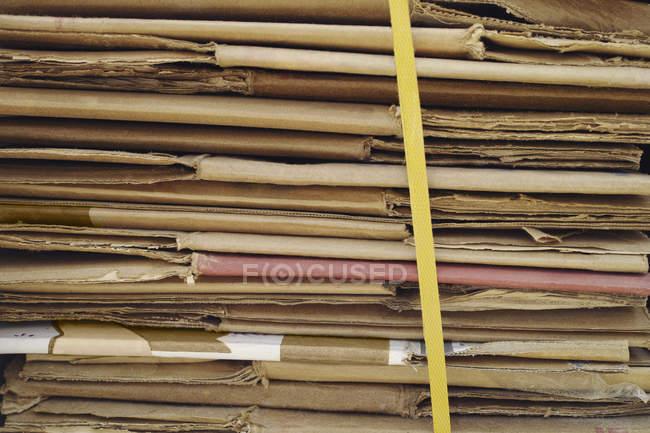 Full frame shot of stacked folded cardboard — Stock Photo