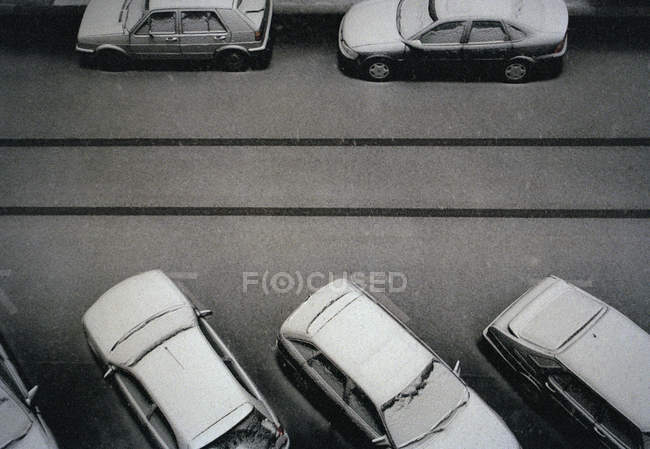 From above parked on street cars covered in snow — Stock Photo