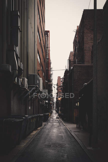 Long alley amidst buildings in city, New York City, New York, USA — Stock Photo