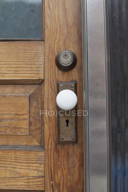 Close up view of closed wooden door — Stock Photo