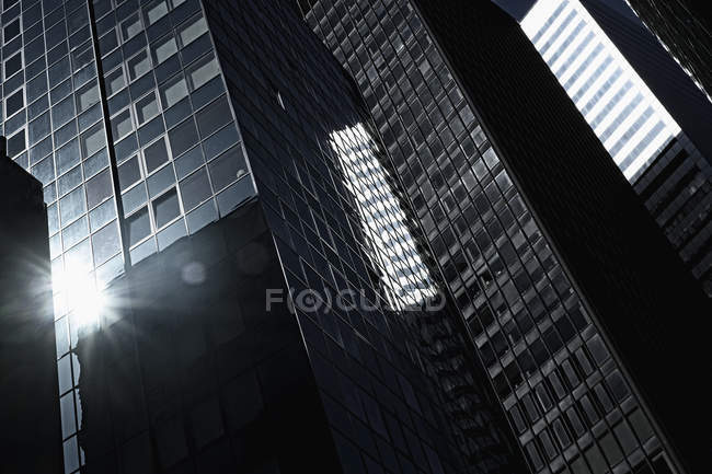 Row of skyscrapers reflecting bright sun — Stock Photo