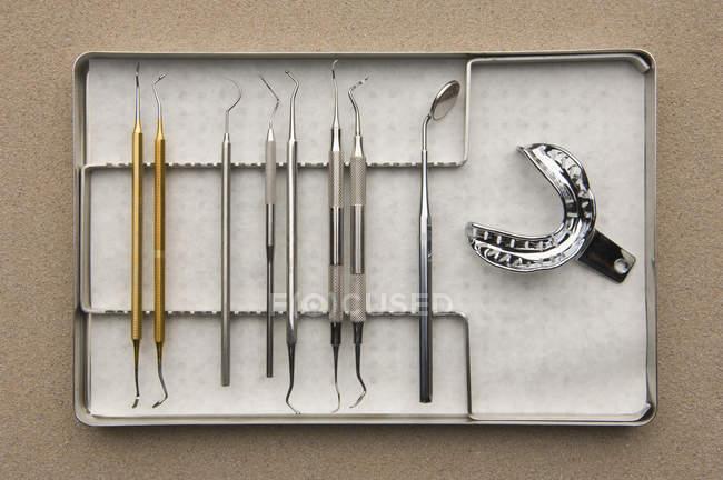Row of dental equipment on tray — Stock Photo