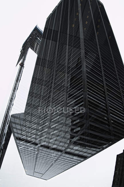 Composite image of corporate skyscraper over white — Stock Photo