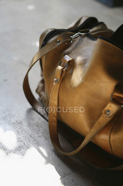 Cropped image of leather gym bag — Stock Photo