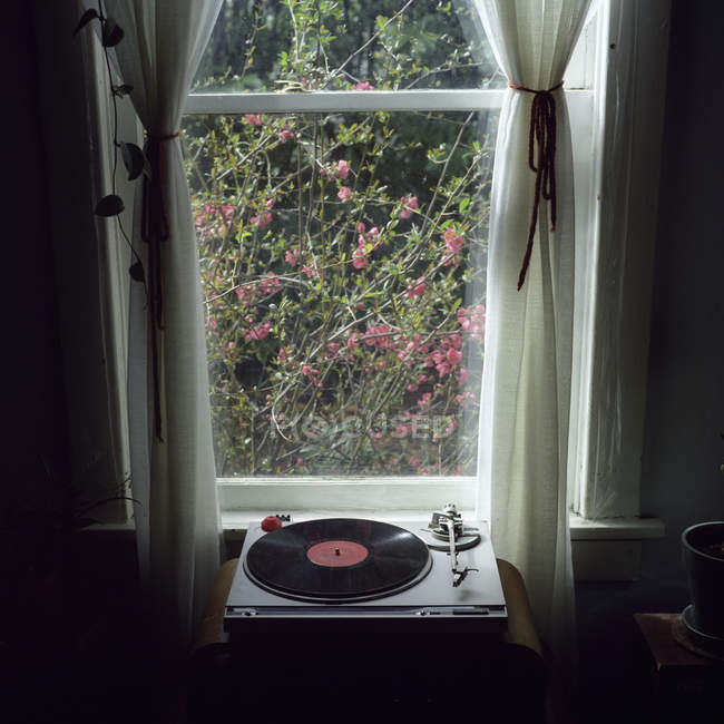 A record player in front of window — Stock Photo