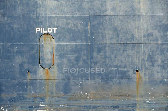 Hull of tanker ship pilot lettering over it — Stock Photo