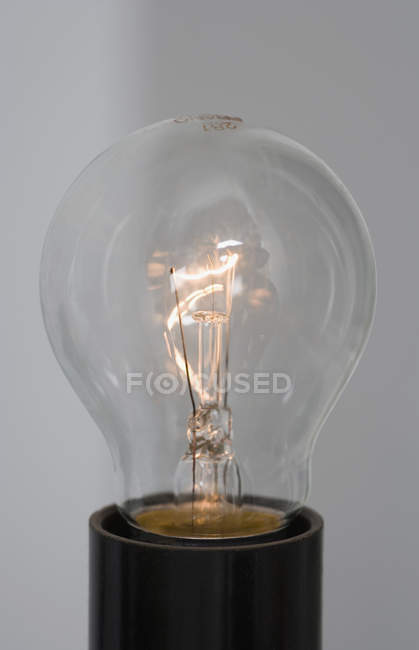 Close up view of lit light bulb — Stock Photo