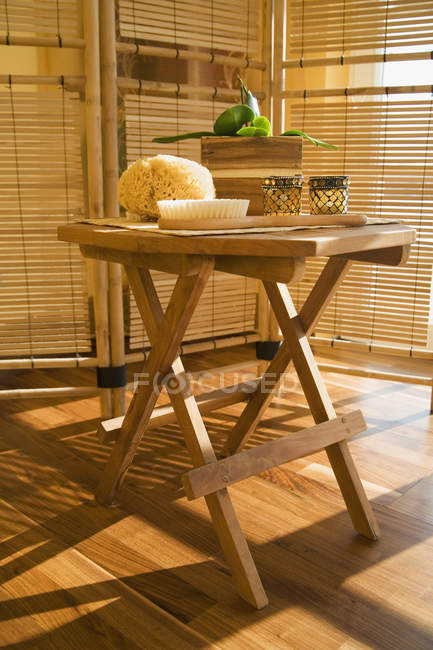 Wooden table with bathroom accessories — Stock Photo