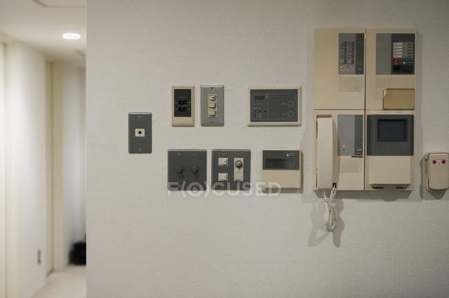 Home security system panels on white wall — Stock Photo