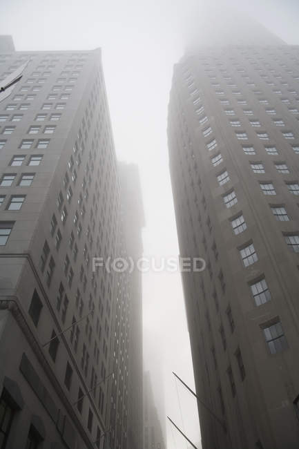 Low angle view of fog between city office buildings — Stock Photo