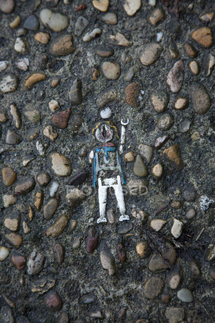 Close up view of vintage toy lodged in cement — Stock Photo