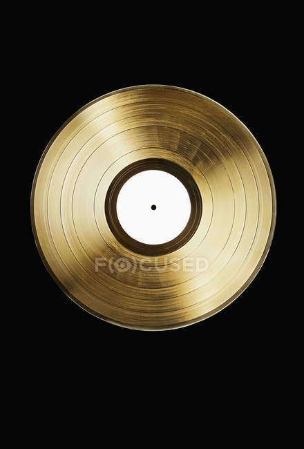 Directly above view of gold record on black background — Stock Photo