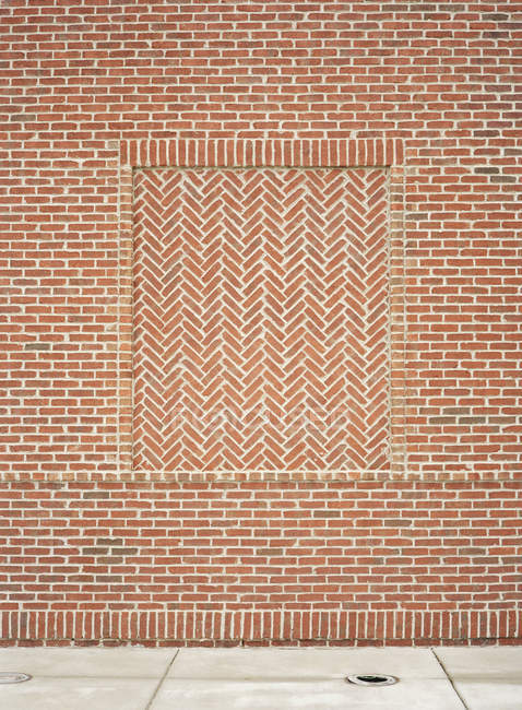 Red brick wall with pattern on building facade — Stock Photo