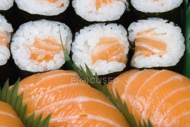 Full frame shot of various sushi in row — Stock Photo