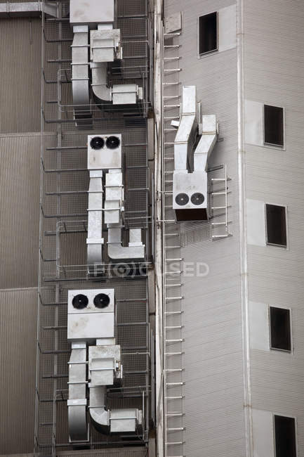Anthropomorphic air vents on side of building - foto de stock