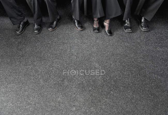 Cropped image of businesspeople wearing shoes — Stock Photo