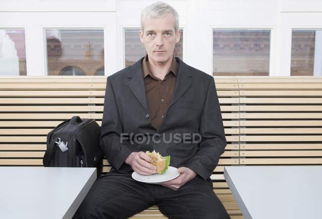 A businessman taking a lunch break — Stock Photo